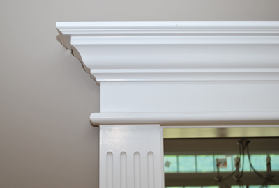 "Ordering your Pediment Heads & Fluted Pilaster is easy. Measure the inside jamb to jamb width, select your pediment head style and pilaster width. With this jamb to jamb dimension the design system will size the pediment head and align the fluted pilasters so that there will be a 1/4"" reveal between the pilasters and the jamb molding. Installed in Wolcott, Connecticut"