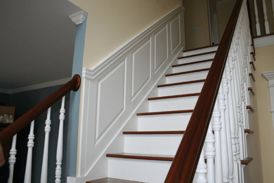 Wainscoting your staircase has never been easier! With a few key measurements we will custom fabricate your Wainscoting panels to the exact slope and diagonal length. The Wainscoting panels will fit perfectly and you will have a grand staircase leading to your foyer! Installed in Woodbury, Connecticut.